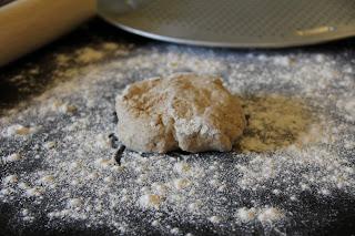 pizza dough on floured surface