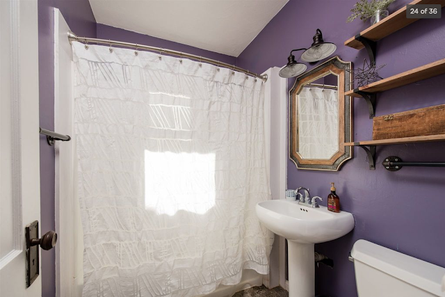 bathroom with deep lilac walls Sears Mitchell •  4616 Arlington Avenue, Fort Wayne, Indiana