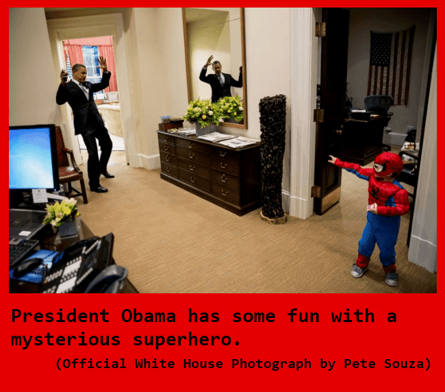 President Barack Obama plays with a pint sized spiderman