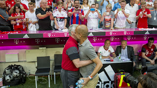 Bayern Manager (Anceloti) left and City's Boss (Pep) seen huging each other