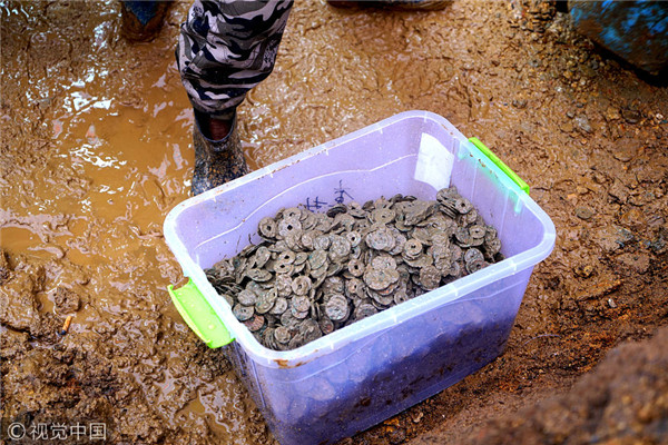 5.6 tons of ancient coins unearthed under house in Jiangxi