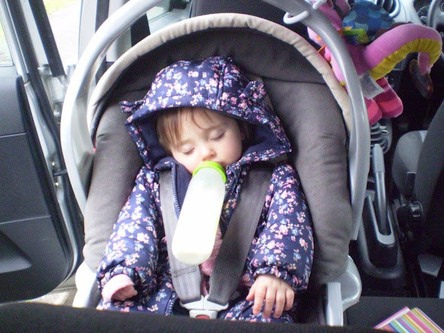 Baby asleep in her car seat