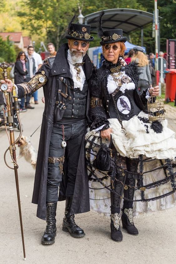 Gothic Victorian Steampunk Couple (man and woman) wearing matching/coordinating black and white costumes. costumes for couples