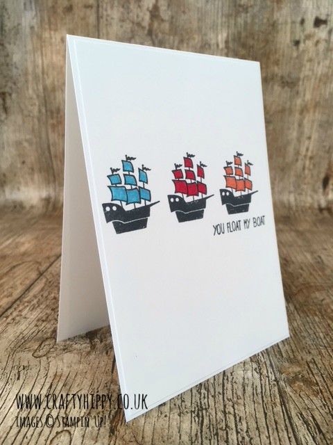 This white greetings card has three hand-stamped ships crossing the middle of the card - they have been made using the Message in a Bottle stamp set and coloured with Pumpkin Pie, Real Red and Tempting Turquoise colours, all by Stampin' Up!