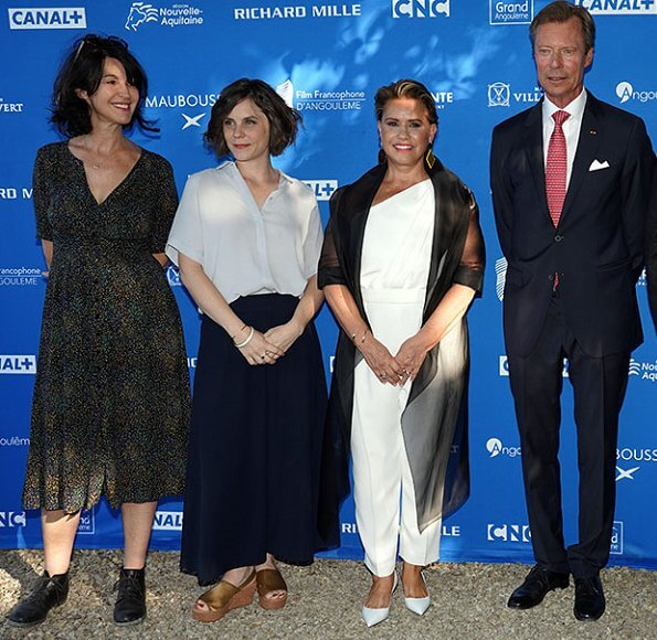 The Duke and Duchess attended French Film Festival and met Catherine Deneuve. floral print jacket