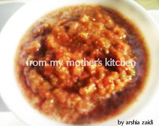 tomatoes, garlic, green chili, coriander leaves in sauce