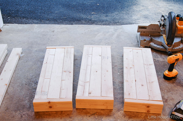 WOW, she built this for $20.00!!!  Learn how to build an inexpensive industrial 2x4 shelving unit!  - Little House of Four
