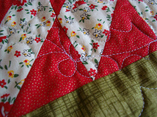 spiky holly leaves and round circles for berries quilted on patchwork