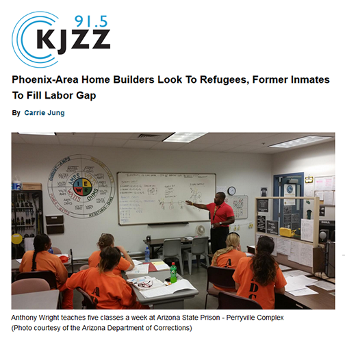 snapshot from KJZZ web site.  KJZZ 91.5 logo.  Headline: Phoenix-Area Home Builders Look to Refugees, Former Inmates to Fill Labor Gap.  Image of an instructor teaching incarcerated students.  Caption: Anthony Wright teaches five classes a week at Arizona State Prison-- Perryville Complex (Photo courtesy of the Arizona Department of Corrections)