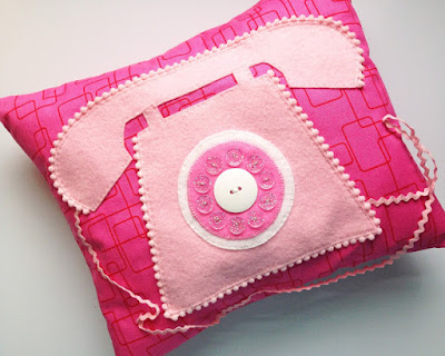 pink telephone pillow