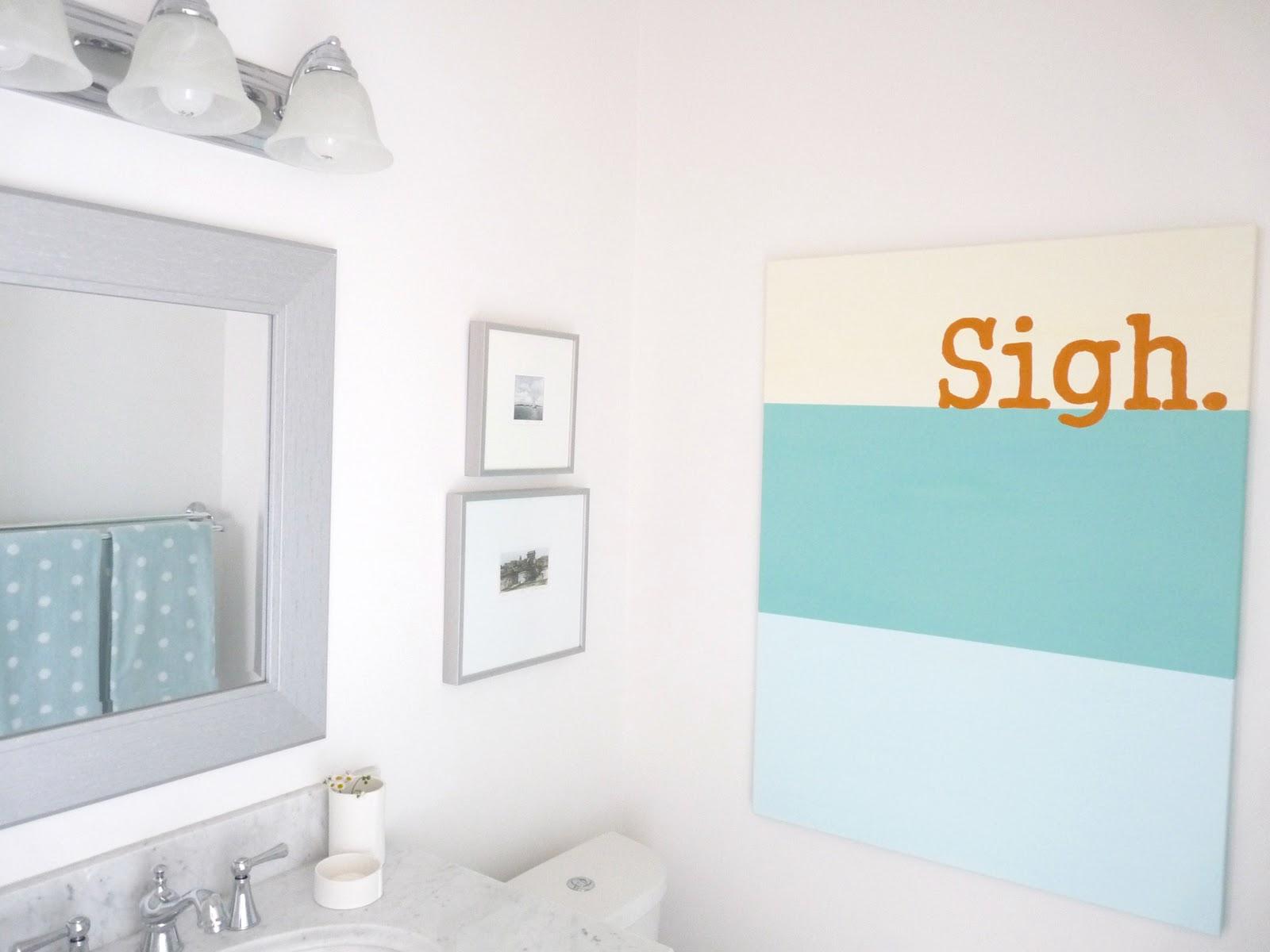 White bathroom aqua art