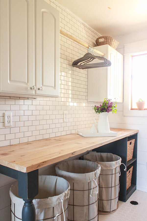 Pretty farmhouse laundry makeover with folding table