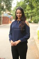 Poojita Super Cute Smile in Blue Top black Trousers at Darsakudu press meet ~ Celebrities Galleries 023.JPG