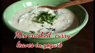 image of mixing yogurt and curry leaves