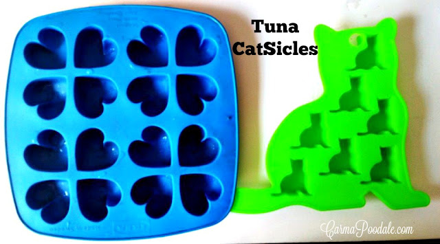 Silicone ice trays in the shape of hearts and cats