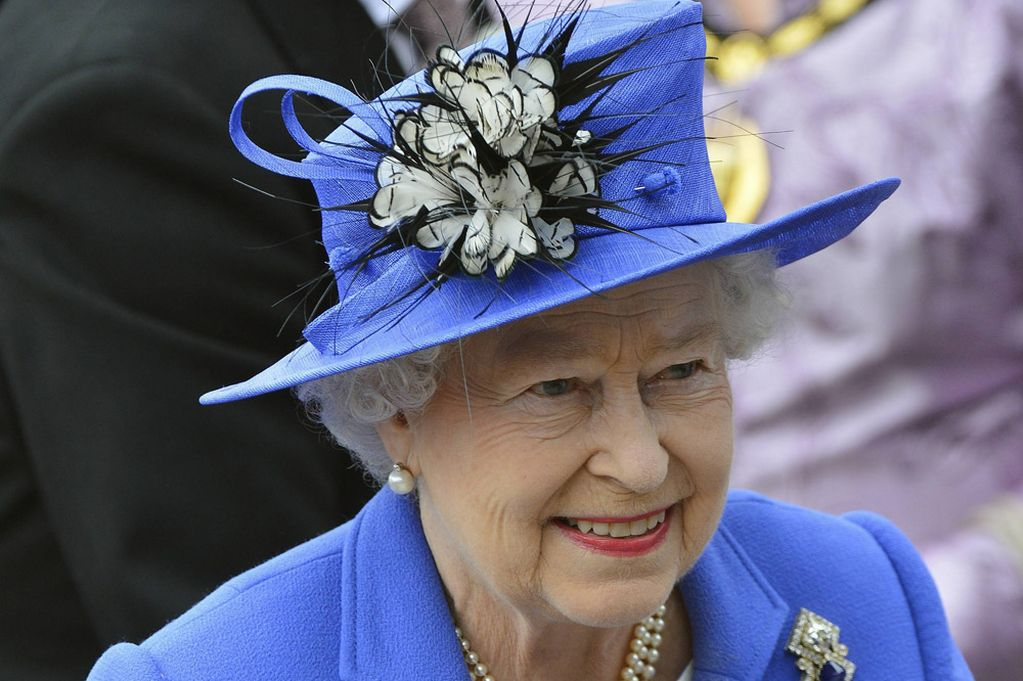 The Queen Royal Blue Hat Decorated With A Black And White Feathered Corsage Is Not Only Of England But Also Hats