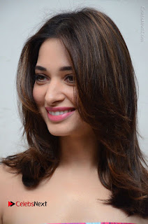 Actress Tamanna Latest Images in Floral Short Dress at Okkadochadu Movie Promotions  0003.JPG
