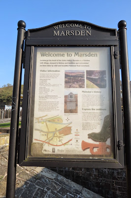 A picture of a sign with information and illustrations for visitors to the town.