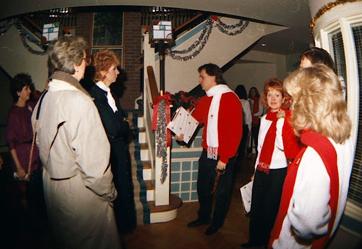 The Stairwell Carollers with guests at Ronald McDonald House 1986