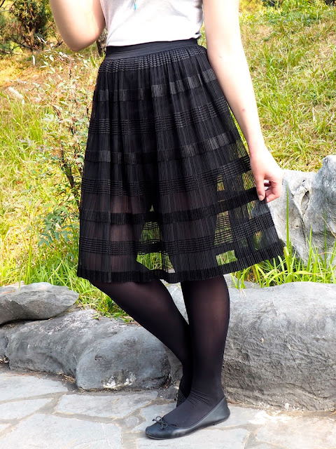 Balletic - outfit close-up of long, floaty, sheer black skirt, with black tights and ballet flats