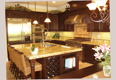 Photo Picture for Gourmet Kitchen Designs With Shinny Table and Soft Lighting