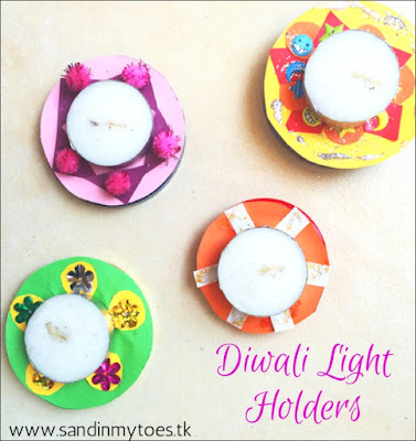 Fun Diwali craft for kids - light holders made with recycled jar lids!