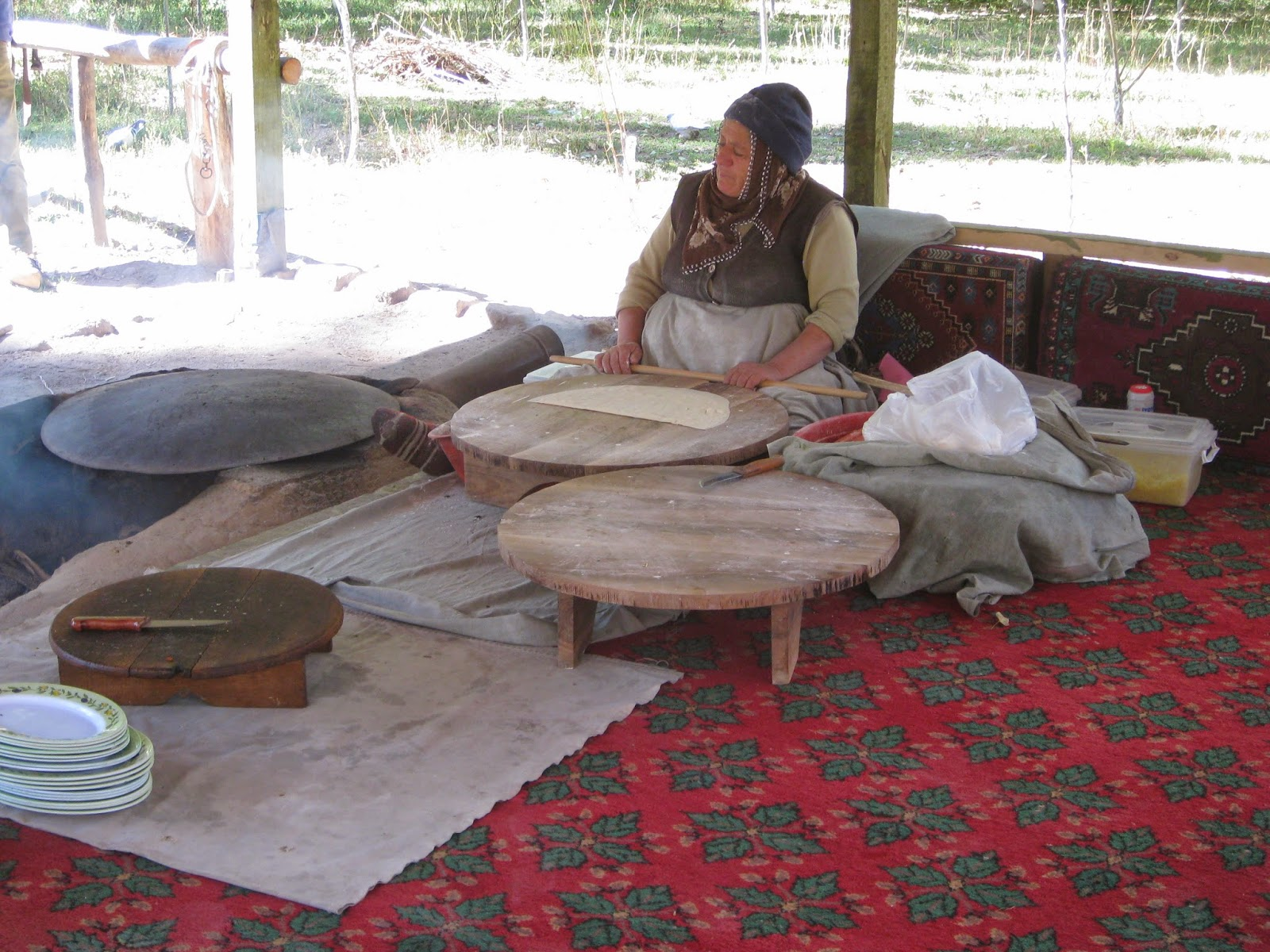 Cappadocia - Woman making gözleme, a pastry made of hand-rolled dough stuffed with various savory fillings