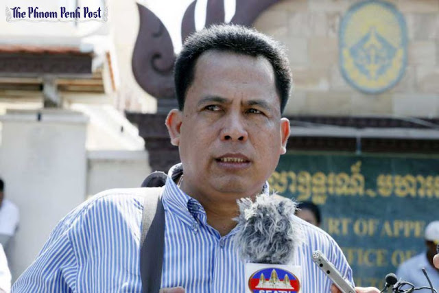 Kem Ley, political analyst and founder of Khmer for Khmer, outside the Court of Appeal in Phnom Penh in March. Kem Ley plans to create five independent political parties in 2015. Vireak Mai