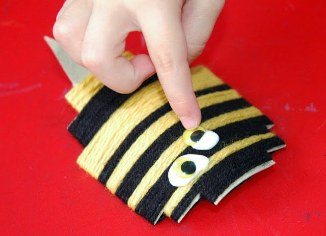 Yarn wrapped bumblebees fine motor insect craft for kids