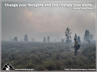 Change your thoughts and you change your world. – Norman Vincent Peale (Firefighters standing, smoke all around)