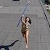 Drone flagra mulher de topless no topo do prédio