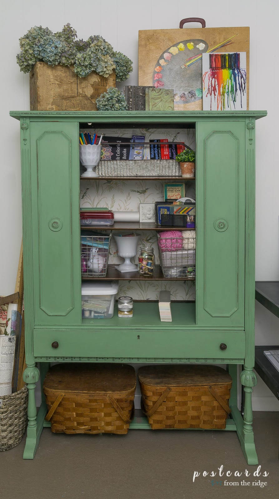 green paint and bird wallpaper on a vintage China cabinet
