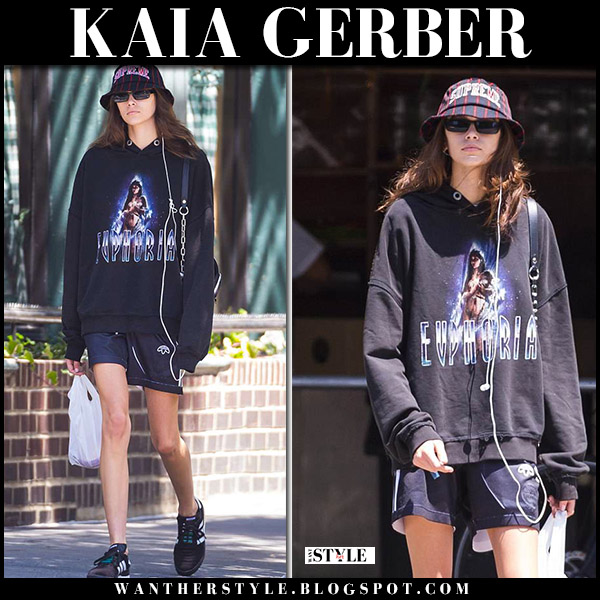 Kaia Gerber in black hoodie, black shorts and sneakers adidas alexander wang model street fashion june 12