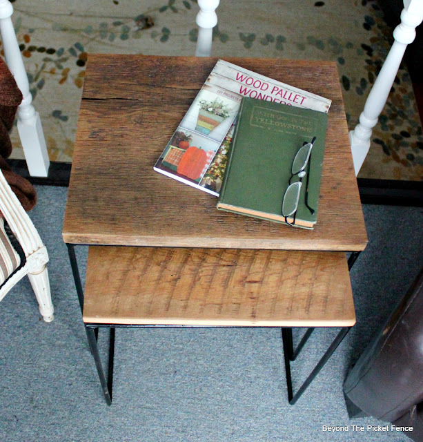 add barn wood to metal table bases to give them a rustic industrial look