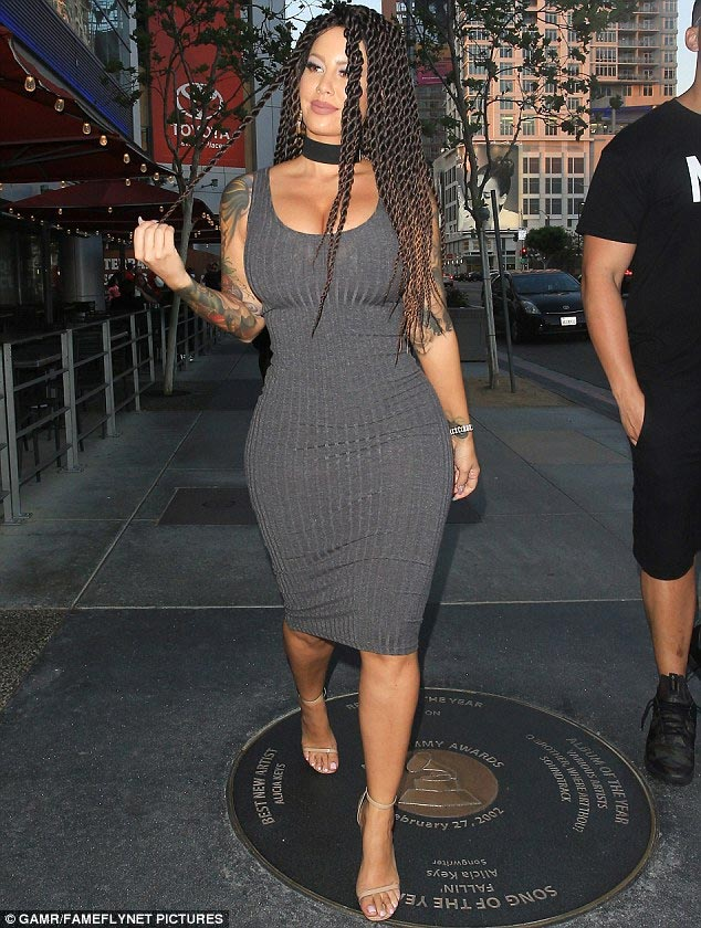 Amber Rose flaunts massive curves as she steps out in braids