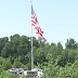 Camping World CEO won't remove massive American flag that flies above his North Carolina RV store despite city's lawsuit and fines