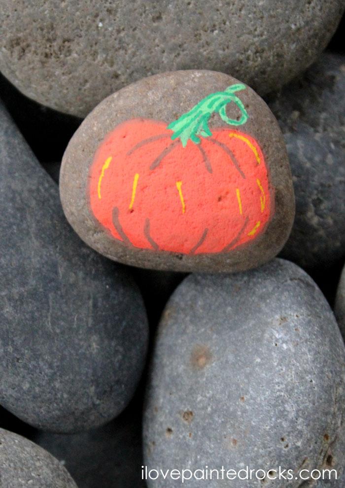 Pumpkin rock painting idea for fall