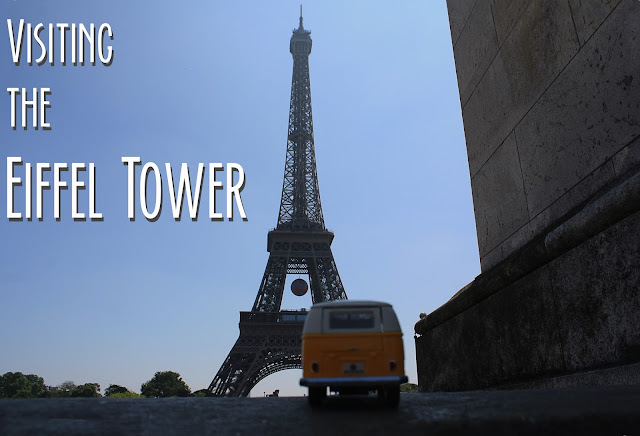 Visiting the Eiffel Tower title card with yellow van in front of the Eiffel Tower