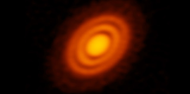 ALMA image of the protoplanetary disk surrounding the young star HD 163296 as seen in dust. New observations suggested that two planets, each about the size of Saturn, are in orbit around the star. These planets, which are not yet fully formed, revealed themselves by the dual imprint they left in both the dust and the gas portions of the star's protoplanetary disk. Credit: ALMA (ESO/NAOJ/NRAO); A. Isella; B. Saxton (NRAO/AUI/NSF)