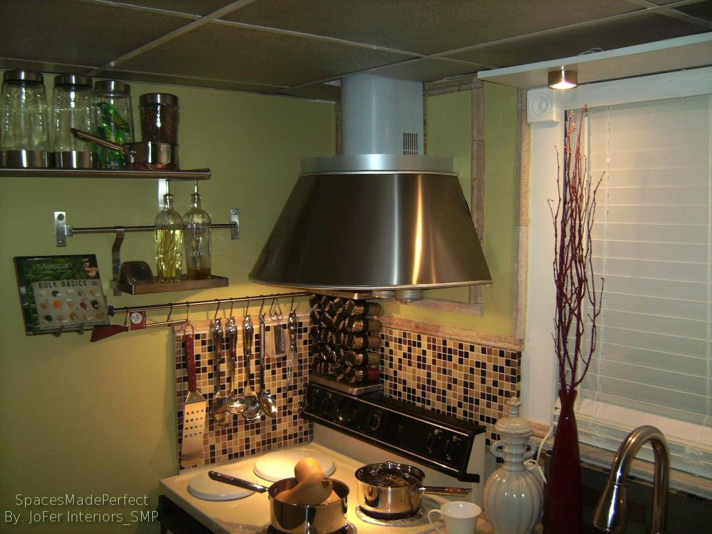 A small Apartment Kitchen redone with Glass tiles, Stainless steel Hood range and appliance racks