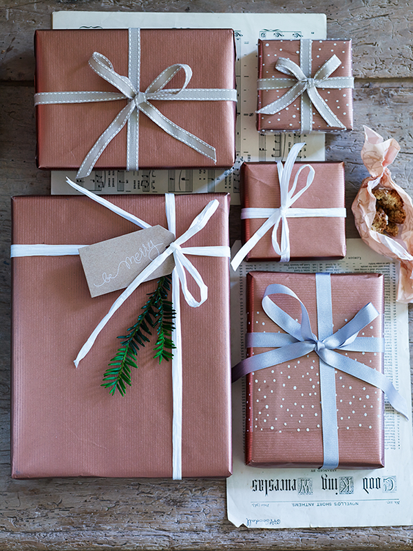 Copper kraft paper gift wrap and snowflake cellophane from Cox and cox