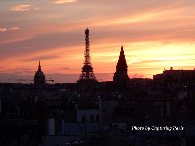 Image of Eiffel Tower in the distance at sun set