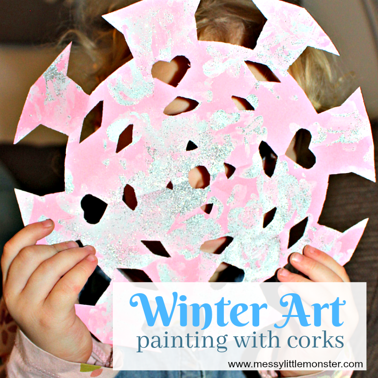 Easy Winter process art for toddlers and preschoolers. Painting with corks on snowflakes and snowman shapes is a fun painting idea for kids. An easy 'The Snowy Day' book activity.