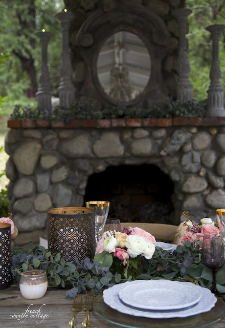 Table setting with punched metal lanterns and fireplace