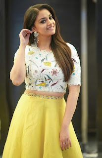 Keerthy Suresh in a White Printed Summer Crop top andyellow skirt