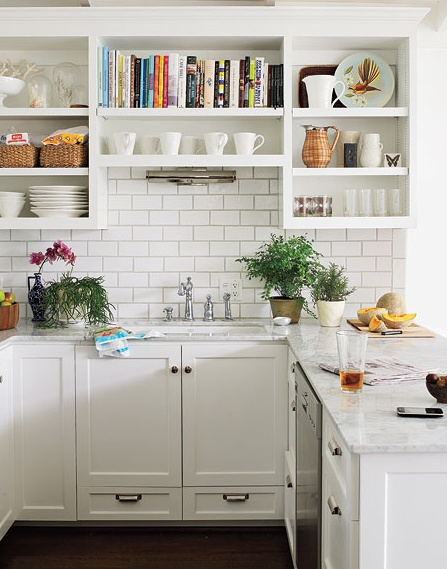 These open kitchen shelves are the perfect place to store cookbooks, mugs, and decorative dishes