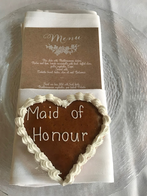 ginger bread heart maid of honour, Table decor with Hessians, wood, grey, brown, green, lilac, Wedding abroad, Mountain wedding lake-side at the Riessersee Hotel Resort Bavaria, Germany, Garmisch-Partenkirchen
