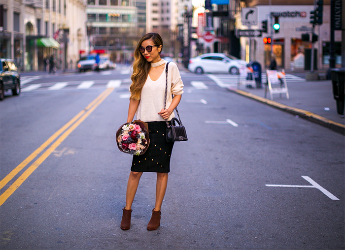 cutout v neck sweater, studded pencil skirt, chanel boy bag, fresh flower, flower bouquet, matt bernson ankle boots, kendra scott earrings, quay sunglasses, holiday date night outfit ideas, san francisco fashion blog, san francisco street style