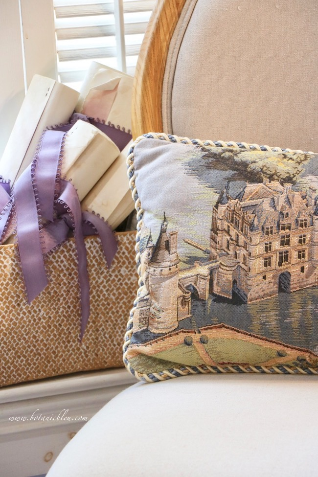 needlepoint pillow of chenonceau adds french country style to master bathroom