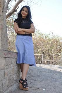 Actress Nitya Shetty Latest Stills in Short Skirt at Padesave Interview  0032.jpg